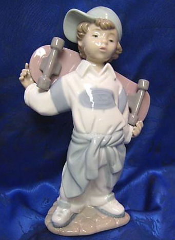 Retired Lladro Boy Figurine